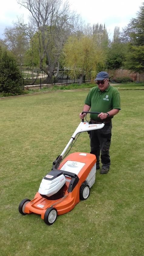 Gardener, Jon, with electric mower